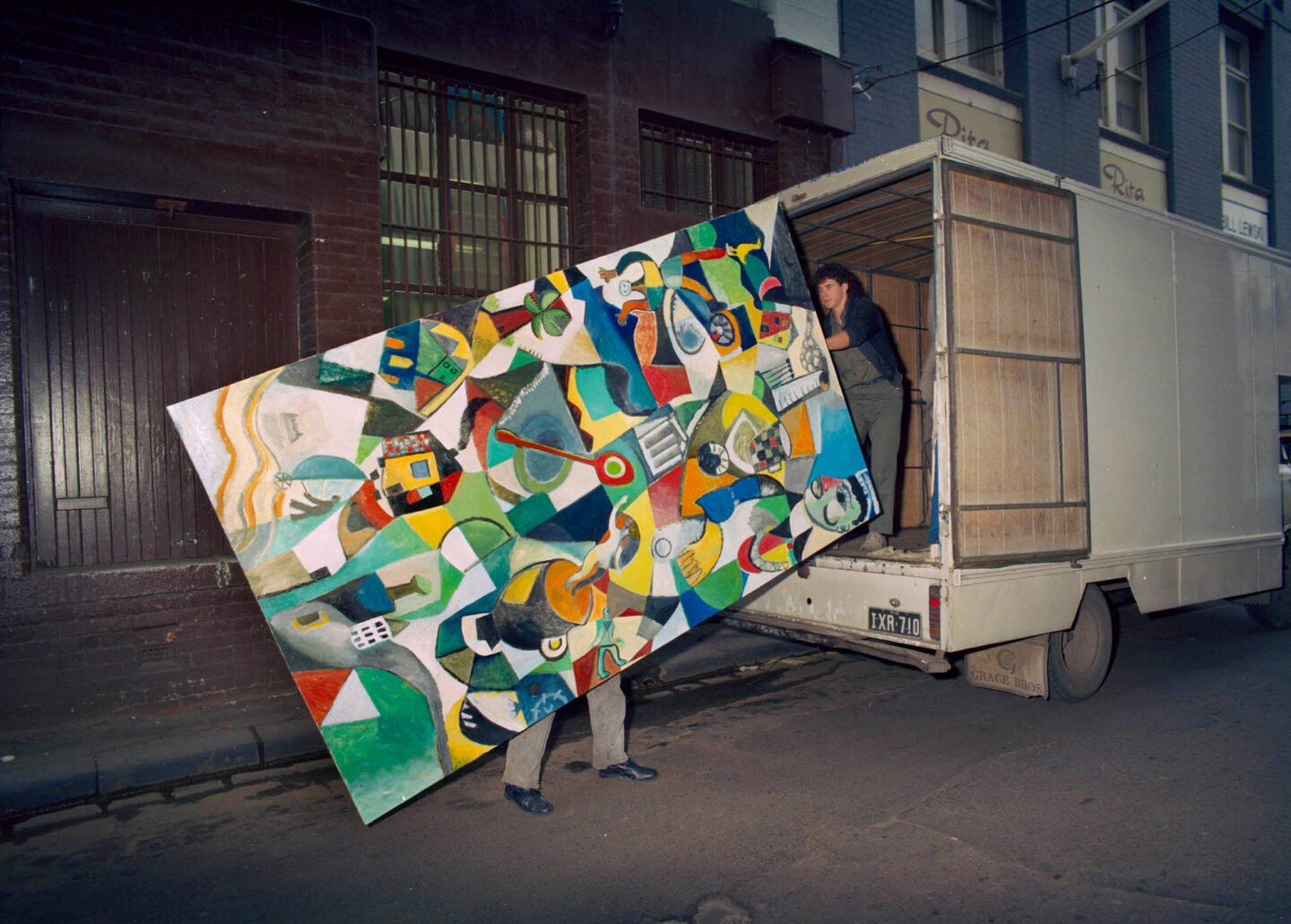 David Larwill moving one of the finished panels for the Australian National Gallery from the Lennox Street studio, 1986. Photo: John Gollings.